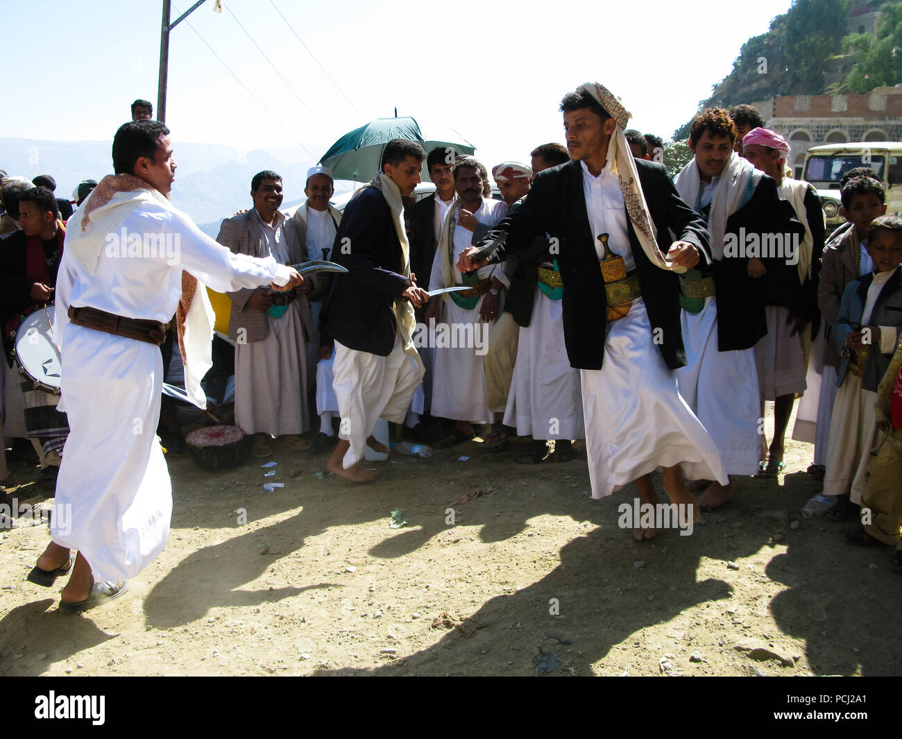 Men dancing with national traditional daggers aka Jambia at the wedding ceremony - 05-11-2009 Sanaa, Yemen - Stock Image