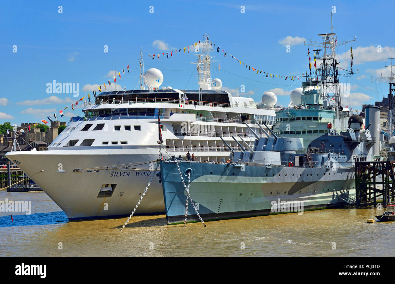 Silver Wind cruise ship moored next to HMS Belfast on the River Thames, London, England, UK. August 2018 Stock Photo