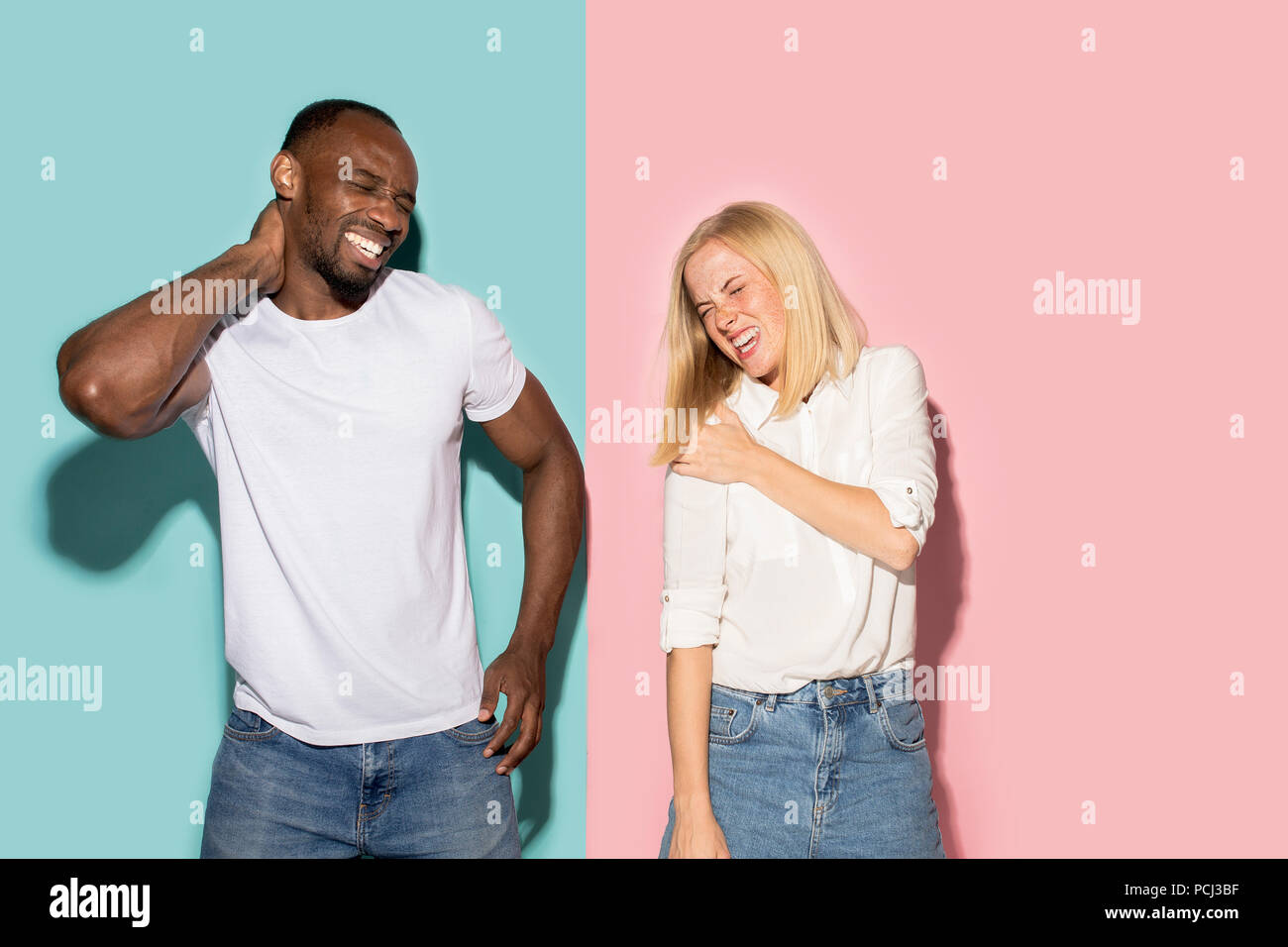 Young couple with a pain in the shoulder - Stock Image