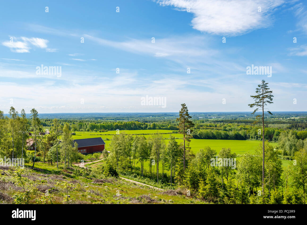 View of rural landscape with fields and a barn - Stock Image