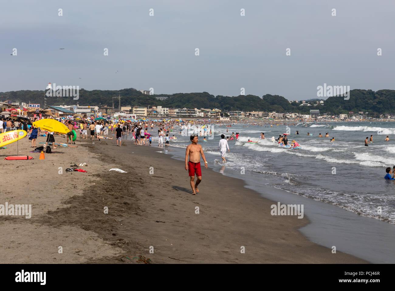People on Yuigahama Beach, July; Kamakura, Kanagawa Prefecture, Japan - Stock Image