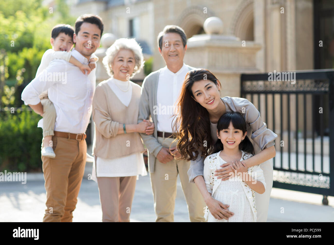 Portrait of happy Chinese family - Stock Image