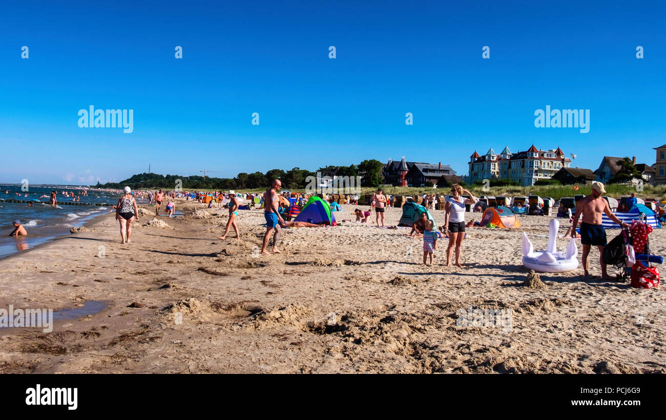 Children play on Bansin beach as People holiday at the Baltic sea resort on Usedom Island during 2018 Summer heat wave, Heringsdorf, Germany Bansin be - Stock Image