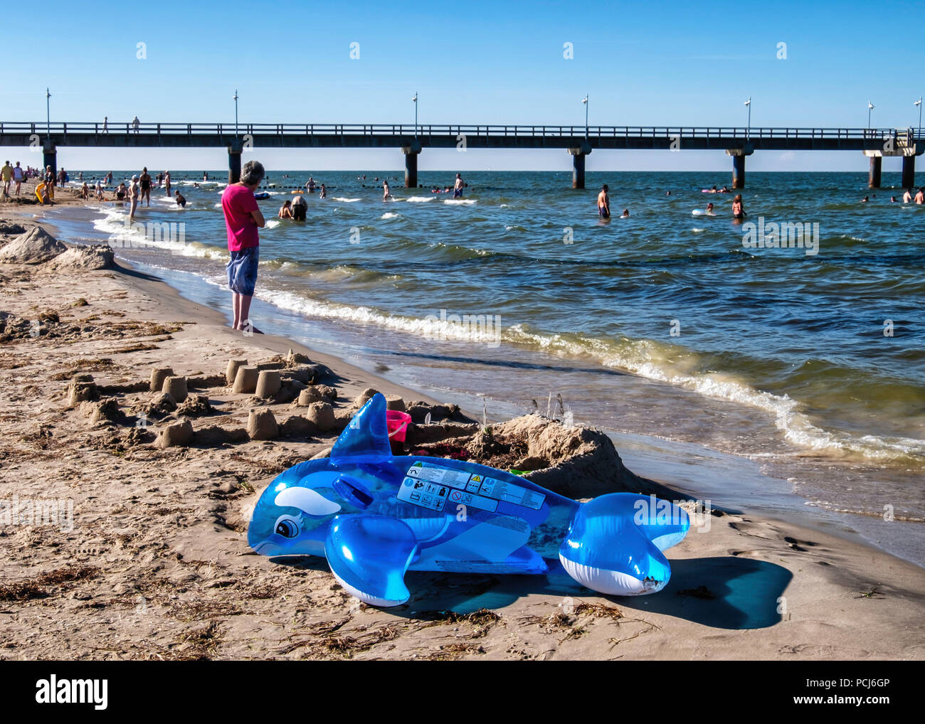 Crowded Bansin beach as people holiday at the Baltic sea resort on Usedom Island during 2018 Summer heat wave, Heringsdorf, Germany Bansin beach is th - Stock Image