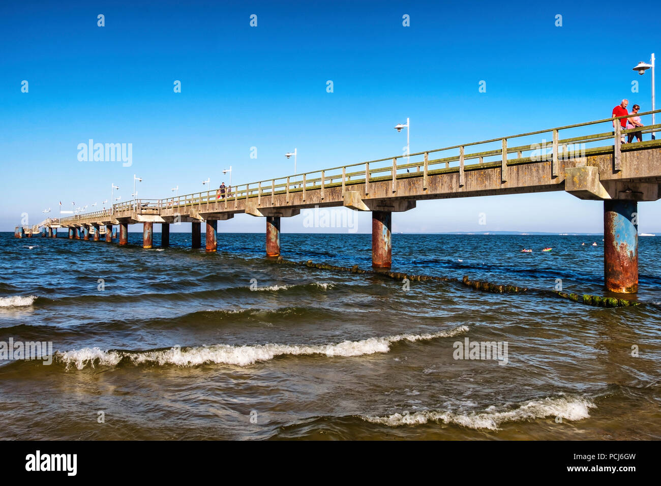People walking on Bansin beach pier at the Baltic sea resort on Usedom Island , Heringsdorf, Germany - Stock Image