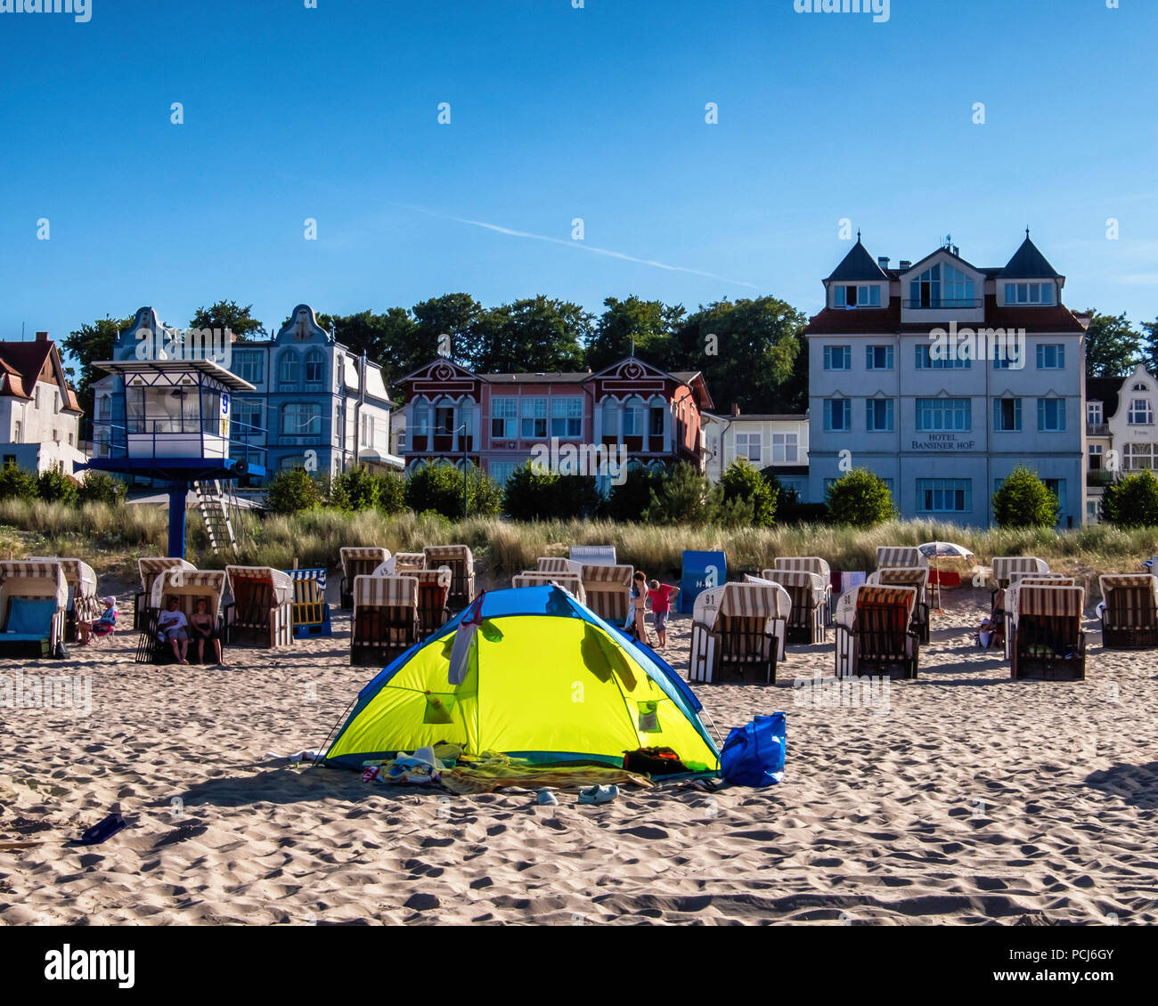 Beach basket chairs, hotels & and colourful tent on  Bansin Beach. Baltic sea resort on Usedom Island , Heringsdorf, Germany Bansin beach is the weste - Stock Image