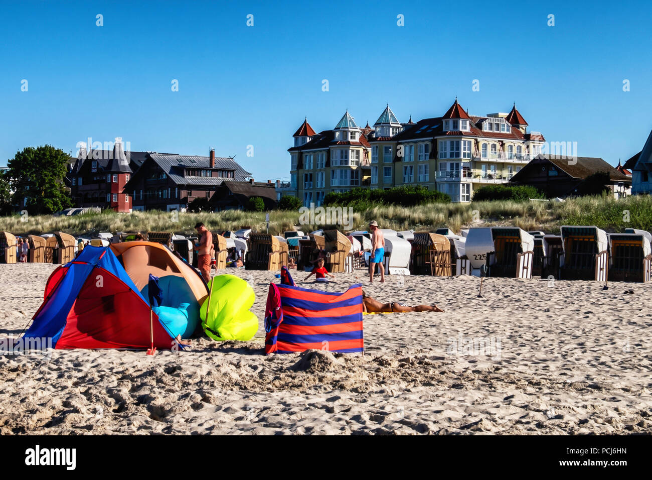 Beach basket chairs, hotels & and colourful tents on  Bansin Beach. Baltic sea resort on Usedom Island , Heringsdorf, Germany Bansin beach is the west - Stock Image