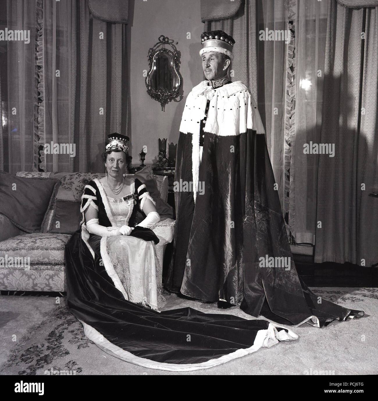 1950s, Sir Basil Brooke, 5th Baronet, with his wife, wearing state ceremonial gowns. The third Prime Minister of Northern Ireland, holding office from 1943 to 1963, he was the country's longest-serving and established a UK record by holding government office continously for 33 years. He was awarded the military cross in 1916. - Stock Image