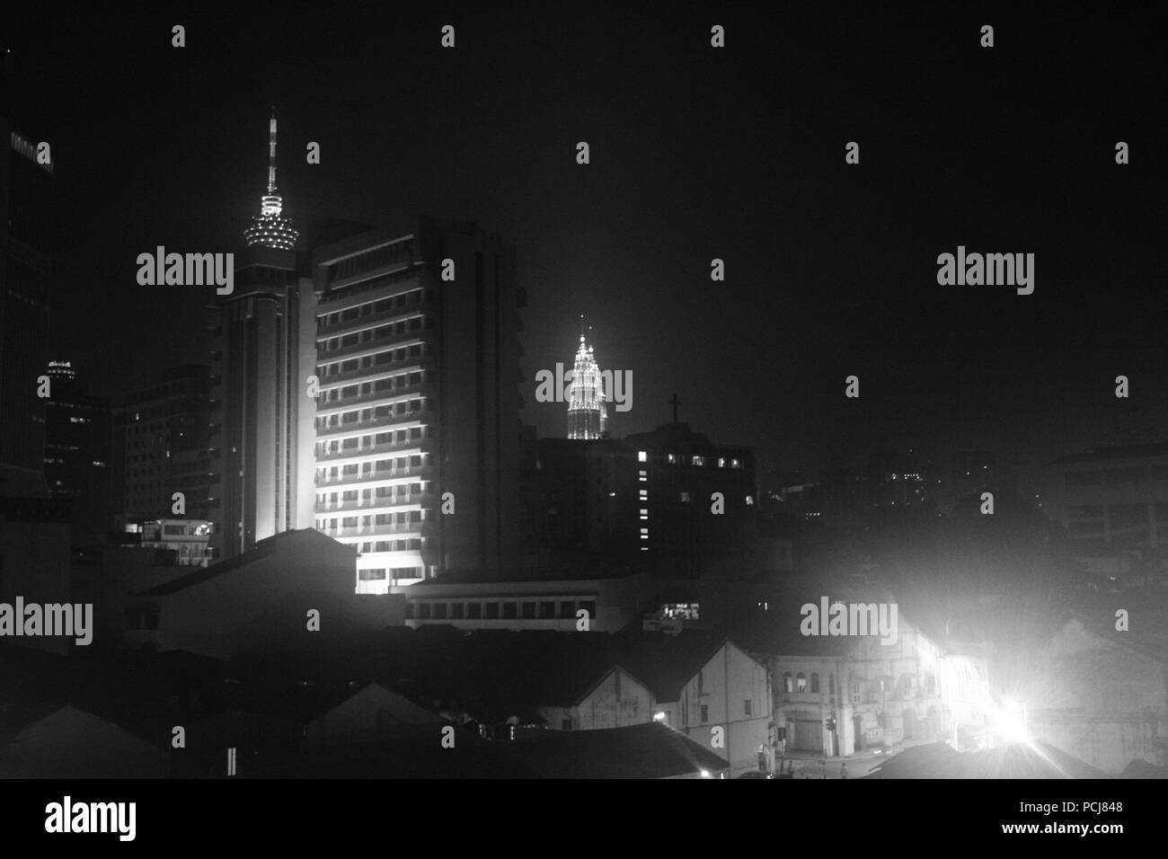 Kuala Lumpur at night from China Town in black and white - Stock Image