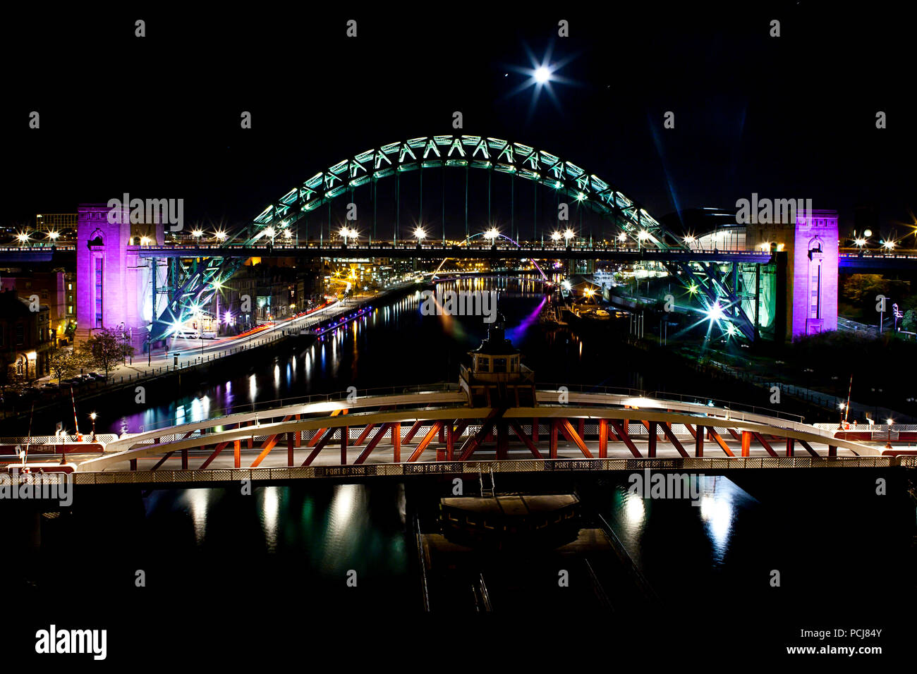 Moonrise over Newcastle and Gateshead Bridges - Stock Image