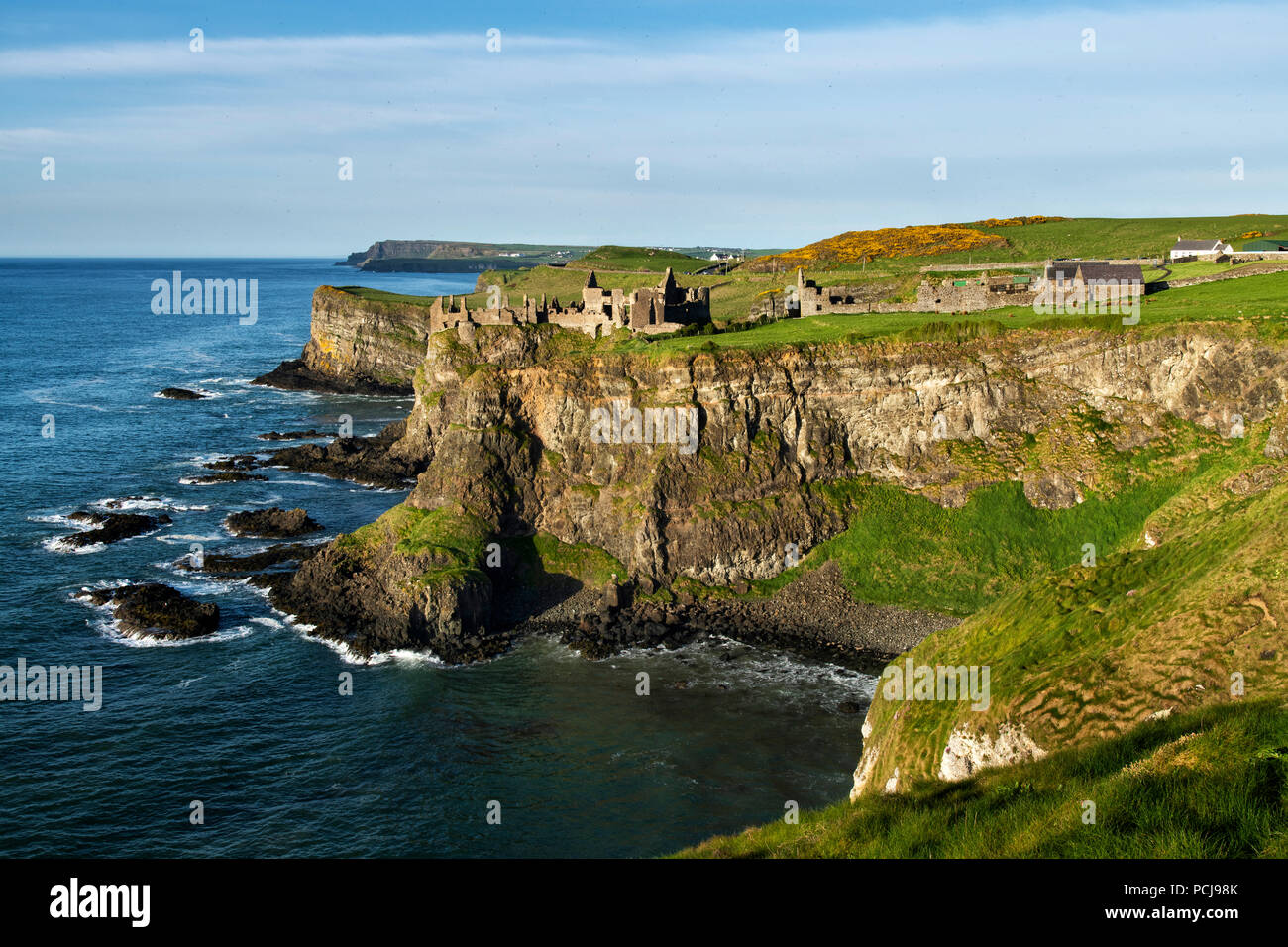 Ruins of Dunluce castle on the Irish coast - Stock Image