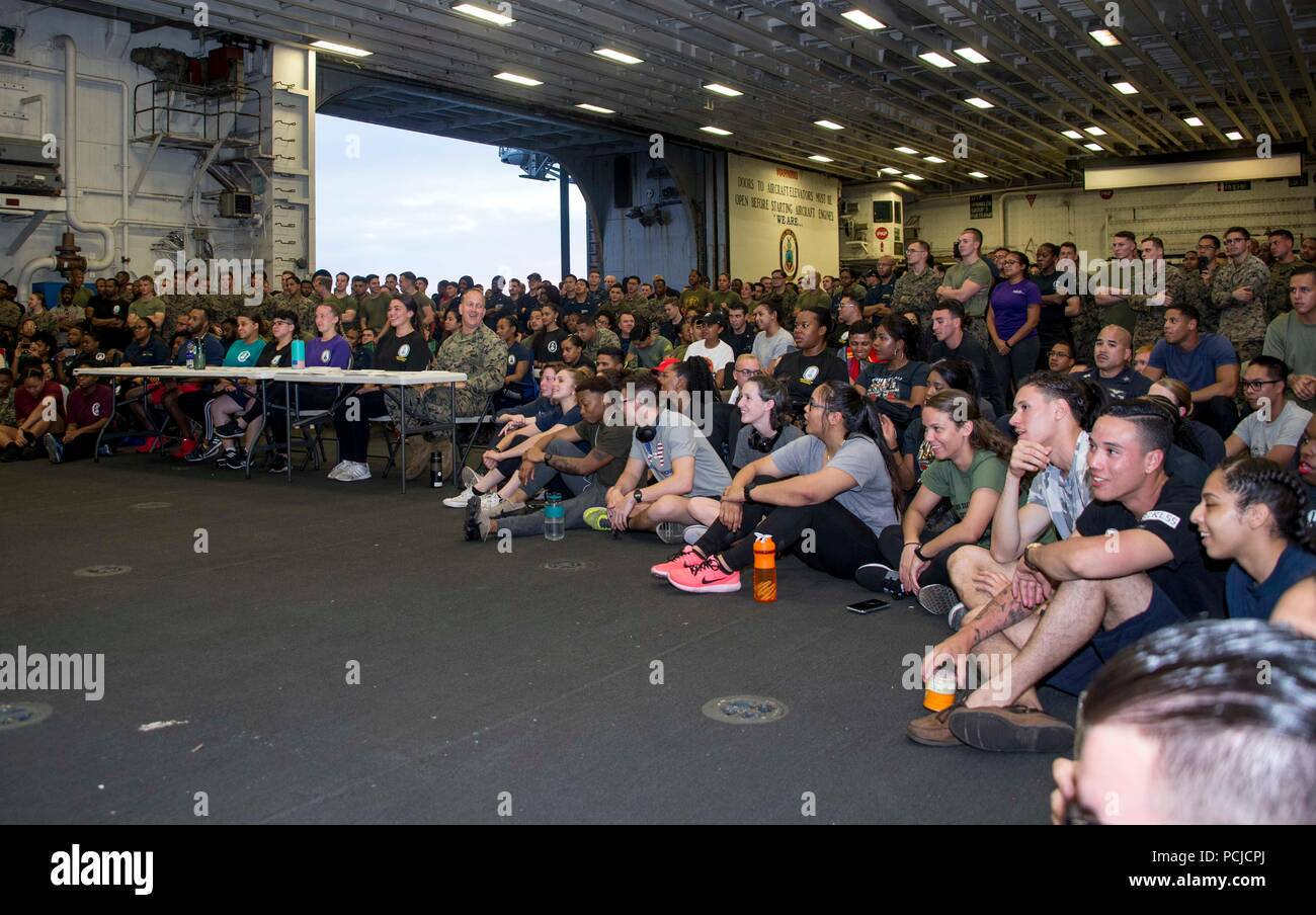 180729-N-ZK016-0004  ATLANTIC OCEAN (July 29, 2018) Sailors and Marines observe a talent show in the hangar bay aboard the Wasp-class amphibious assault ship USS Iwo Jima (LHD 7), July 29, 2018. Iwo Jima, homeported in Mayport, Florida, is conducting naval operations in the U.S. 6th Fleet area of operations in support of U.S. national security interests in Europe and Africa. (U.S. Navy photo by Mass Communication Specialist 3rd Class Joe J. Cardona Gonzalez/Released) Stock Photo