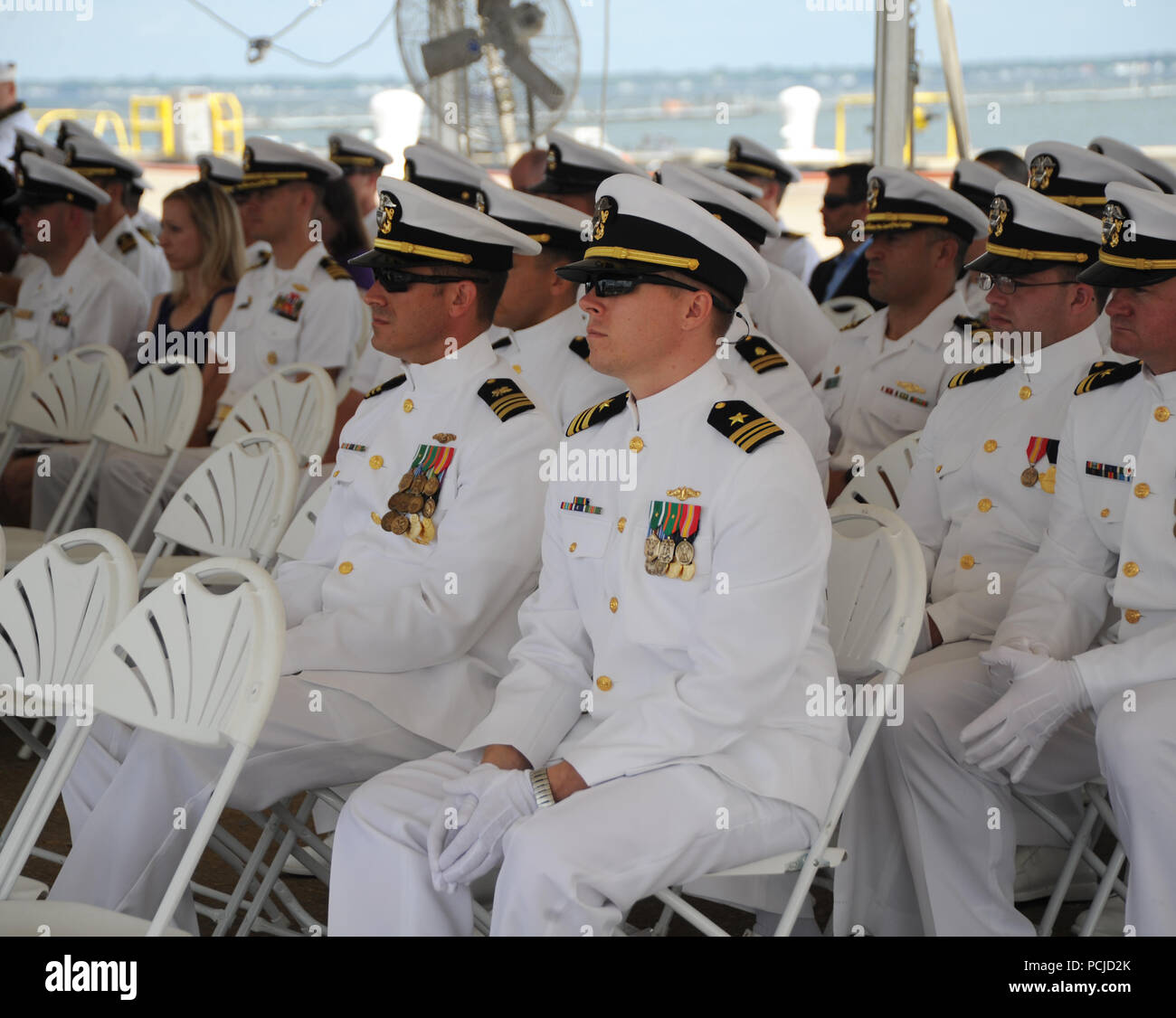 NORFOLK, Va. (Aug. 1, 2018) Sailors attend the Submarine Squadron Six change of command ceremony aboard the Virginia-class attack submarine USS Washington (SSN 787) in Norfolk, Va. Capt. Martin Muckian relieved Hartsfield as Commander, Submarine Squadron Six.  (U.S. Navy photo by Chief Mass Communication Specialist Darryl Wood/Released) - Stock Image