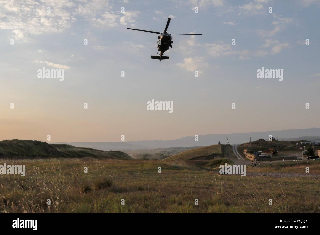 An HH-60 Black Hawk helicopter approaches a landing zone during Noble Partner 18 during a medical evacuation exercise at the Vaziani Training Area, Georgia.  The exercise validated the joint medical evacuation procedures of U.S. and Georgia Armed Forces. Stock Photo