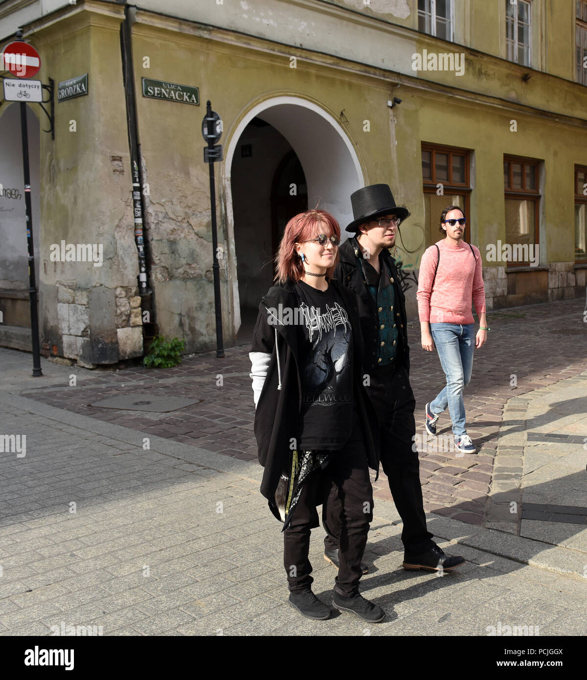 Young couple dressed in flamboyant clothes Krakow Poland 2018 - Stock Image