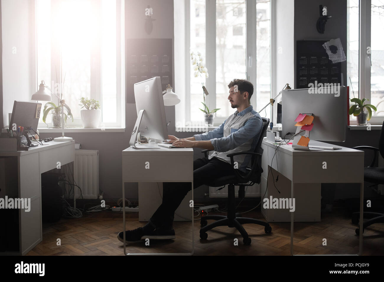 A man working in a modern design office  - Stock Image