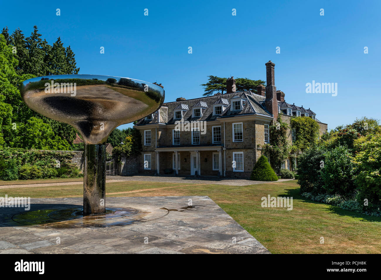 Woolbeding with Unusual Water Feature - Stock Image