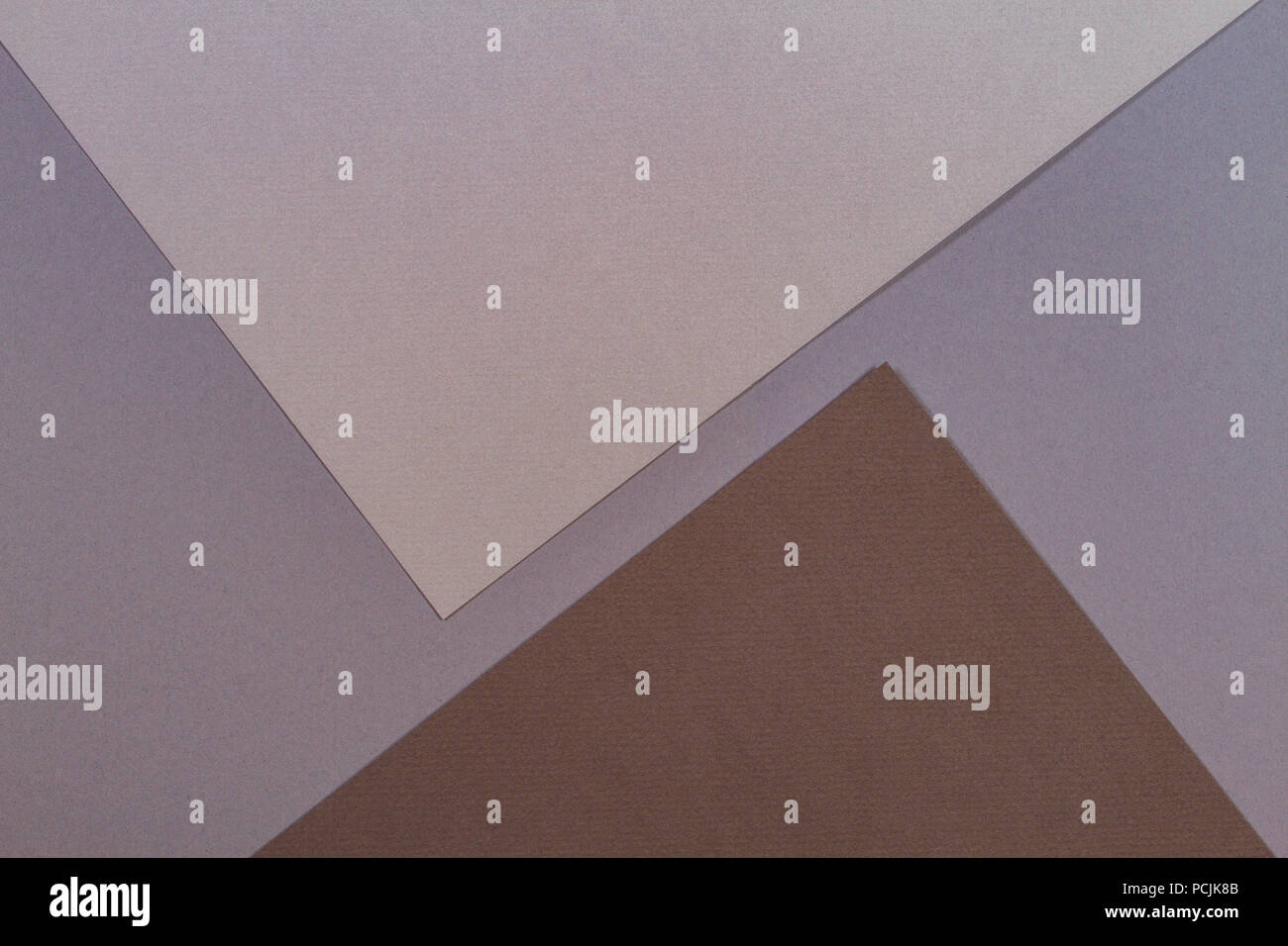 Color papers geometry composition background with gray and brown tones - Stock Image