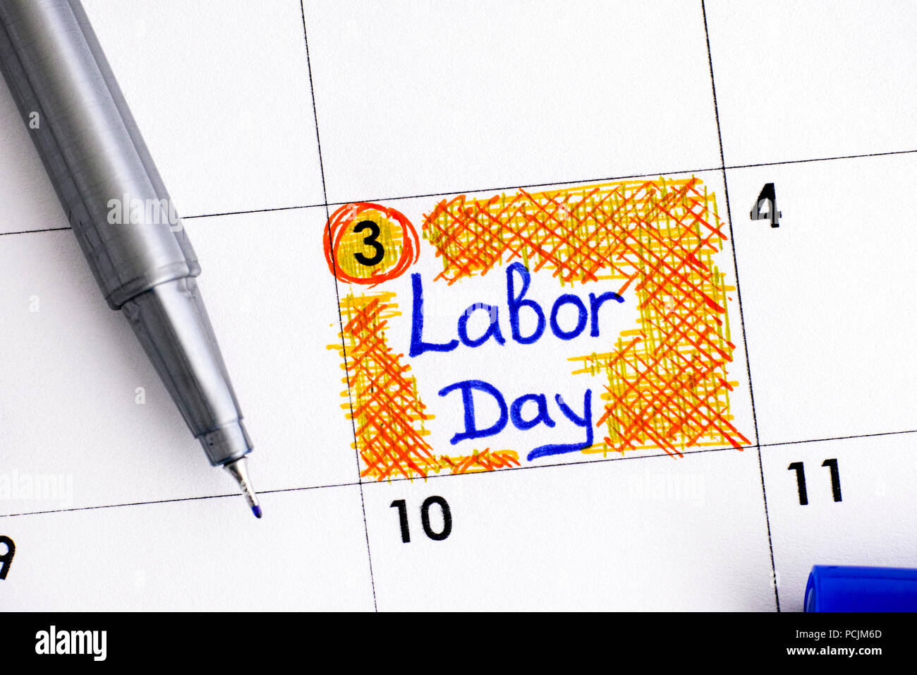 Reminder Labor Day In Calendar With Blue Pen Close Up Stock Photo