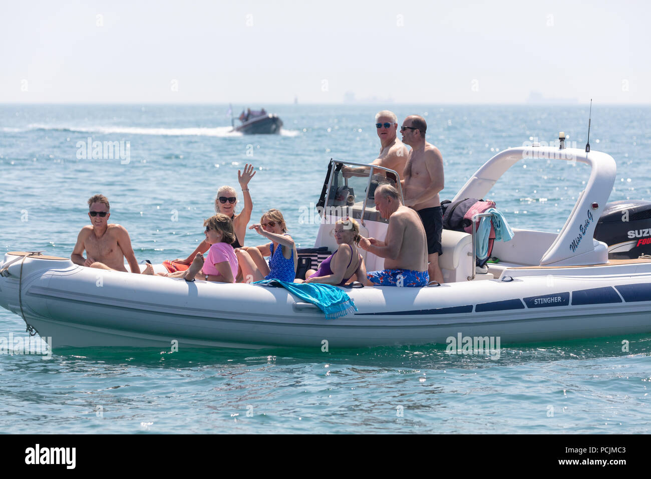 English Channel, Near the Isle of Wight; 7th July 2018; Group of People Watching the Round the island Yacht Race From a RIB - Stock Image