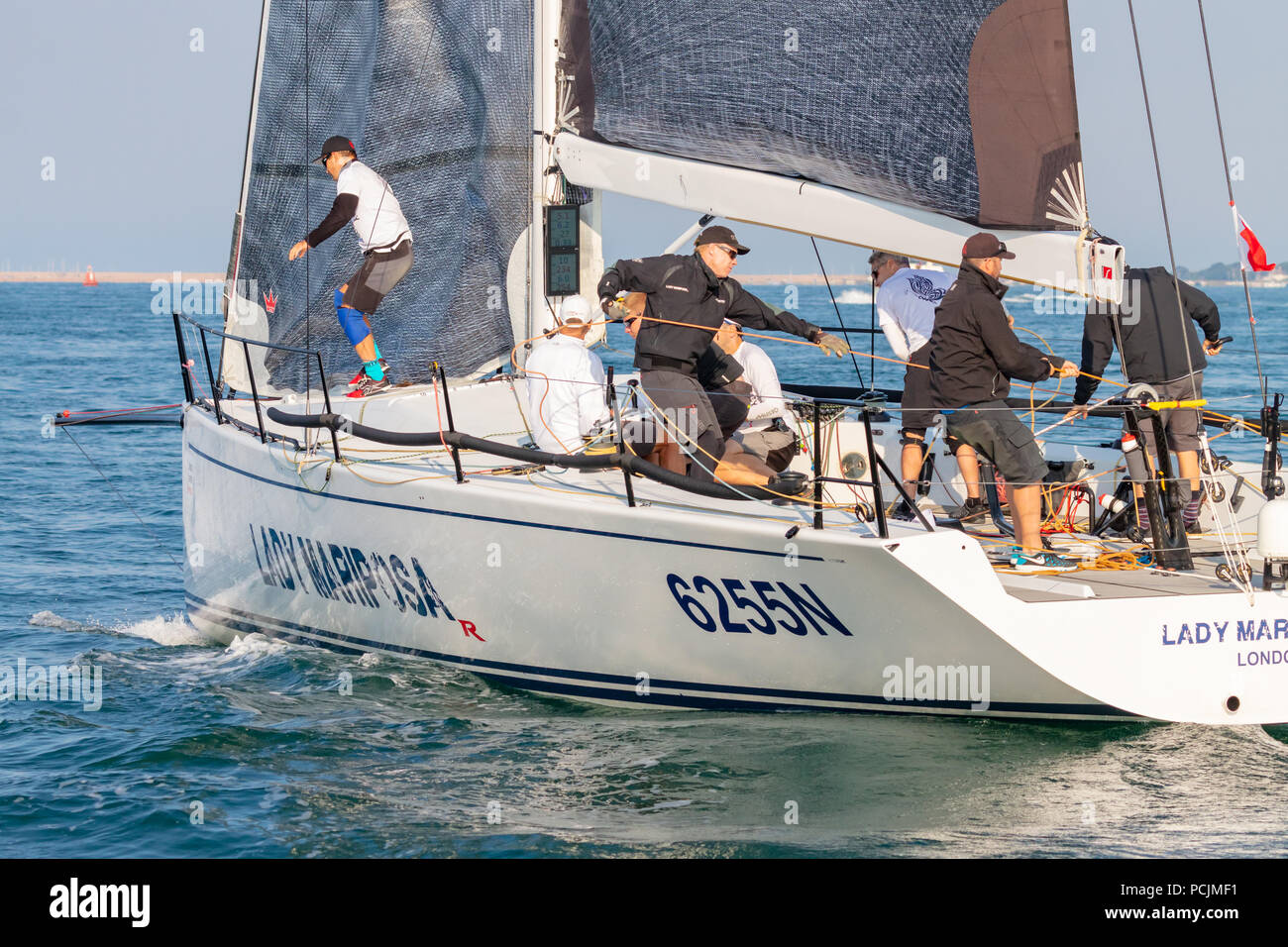 English Channel, Nr Isle of Wight, UK; 7th July 2018; Crew Members Working Aboard Ker 46 Yacht, Lady Mariposa Competing in Round the Island Race - Stock Image