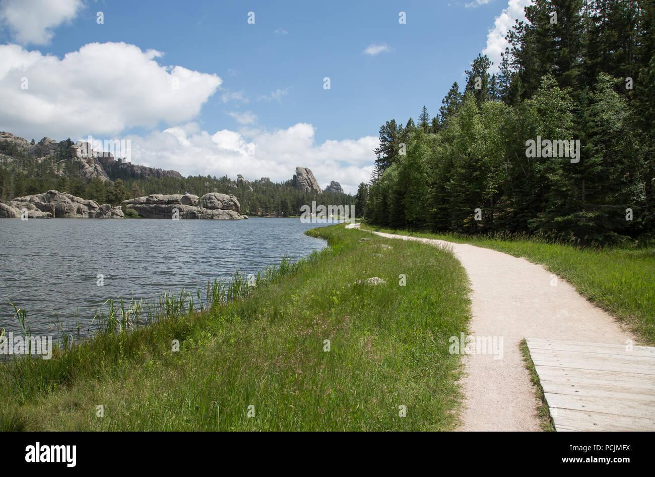 Walking Path along mountain lake - Stock Image
