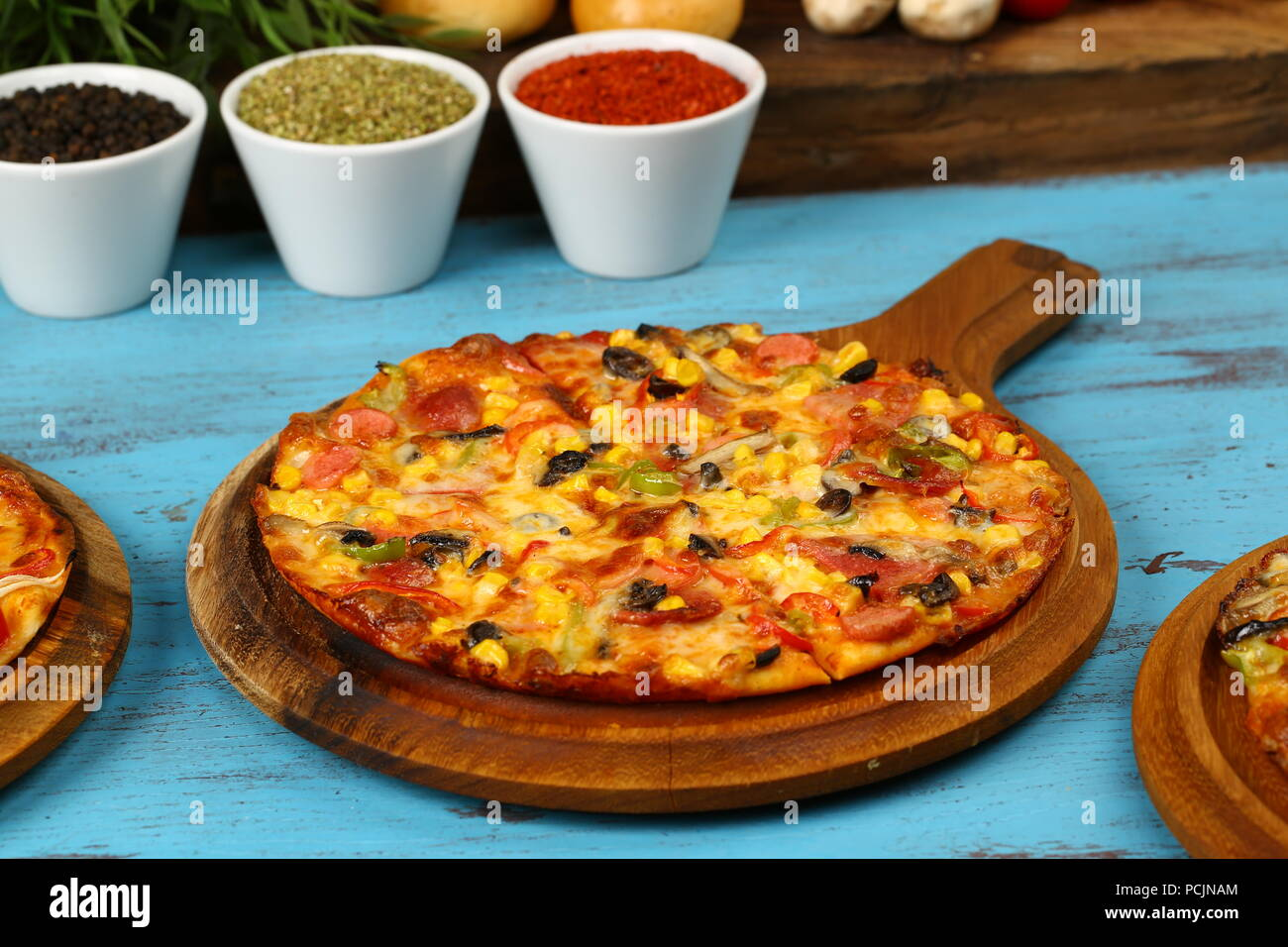 Delicious italian pizza on the wood table Stock Photo