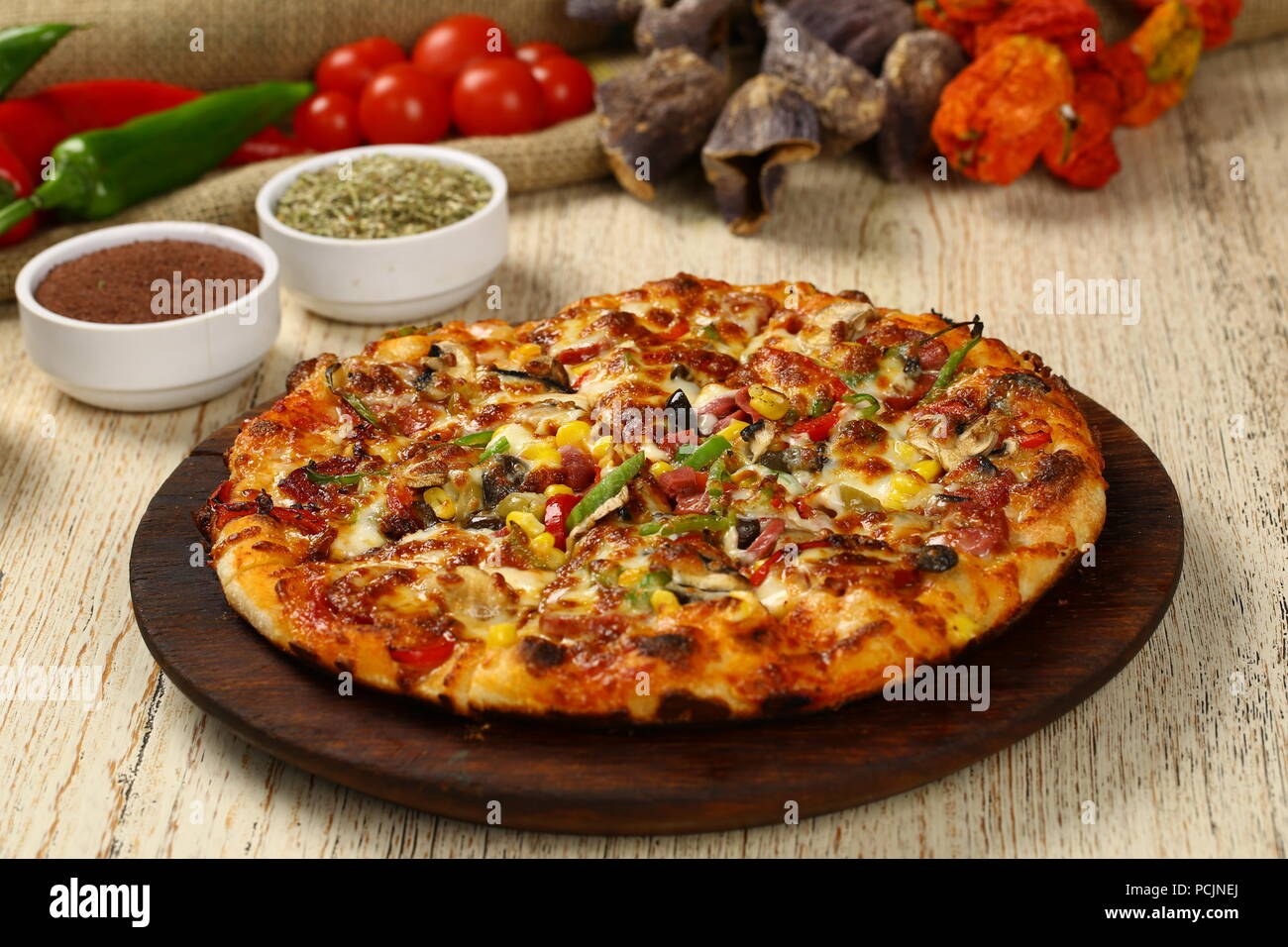 Delicious italian pizza on the wood table - Stock Image