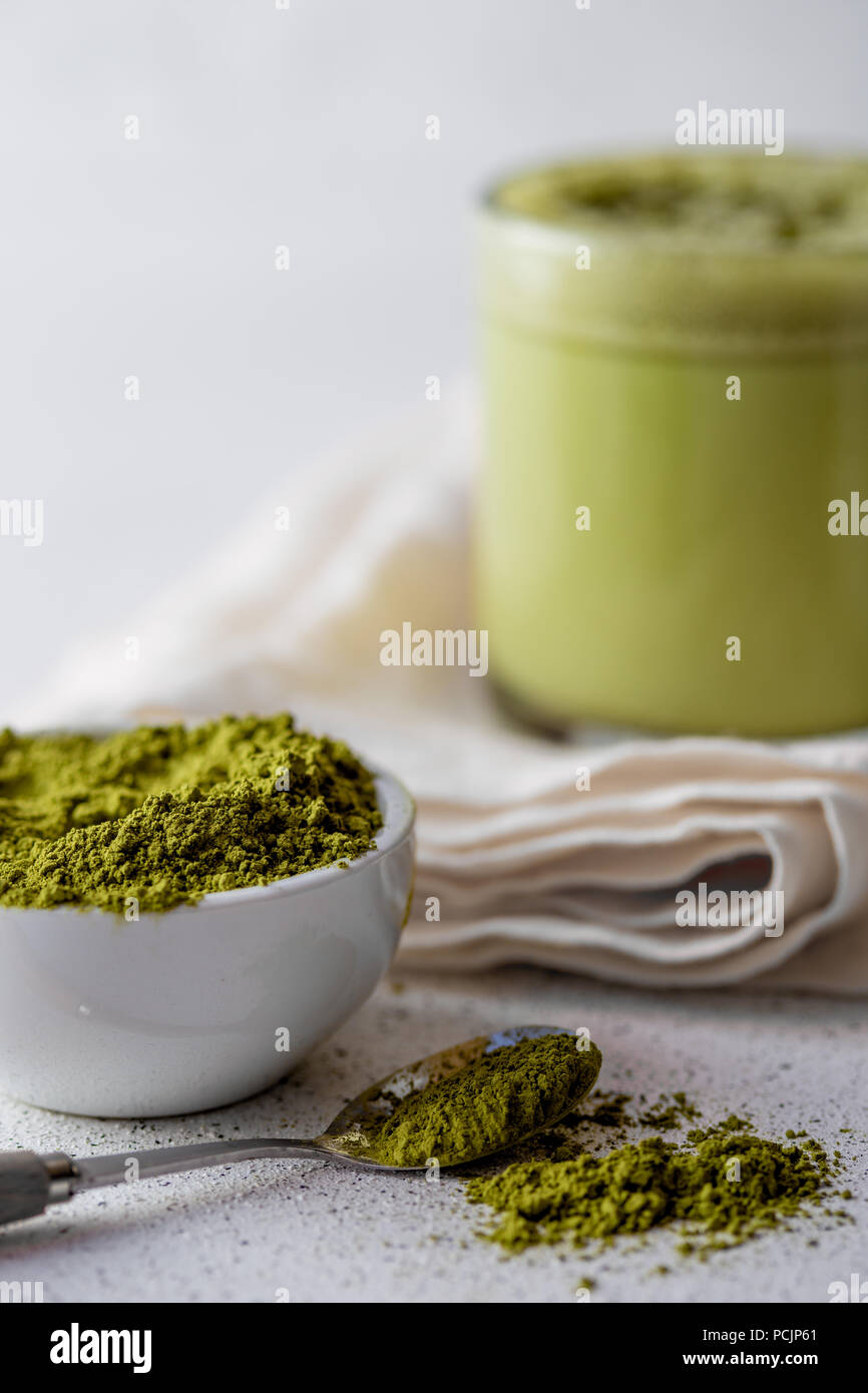 BULLETPROOF MATCHA. Ketogenic keto diet hot drink. Tea matcha blended with coconut oil and butter. Cup of bulletproof matcha and ingredients on white background - Stock Image
