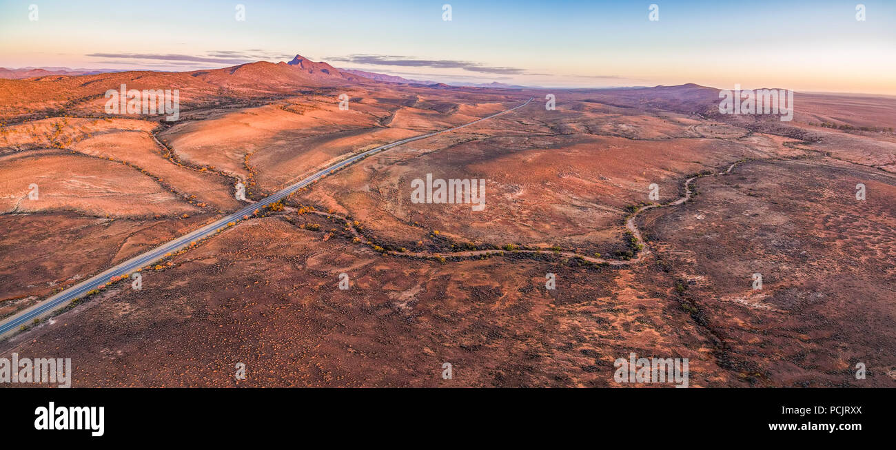 Aerial panorama of sunset over rugged alien landscape of Flinders Ranges in South Australia - Stock Image