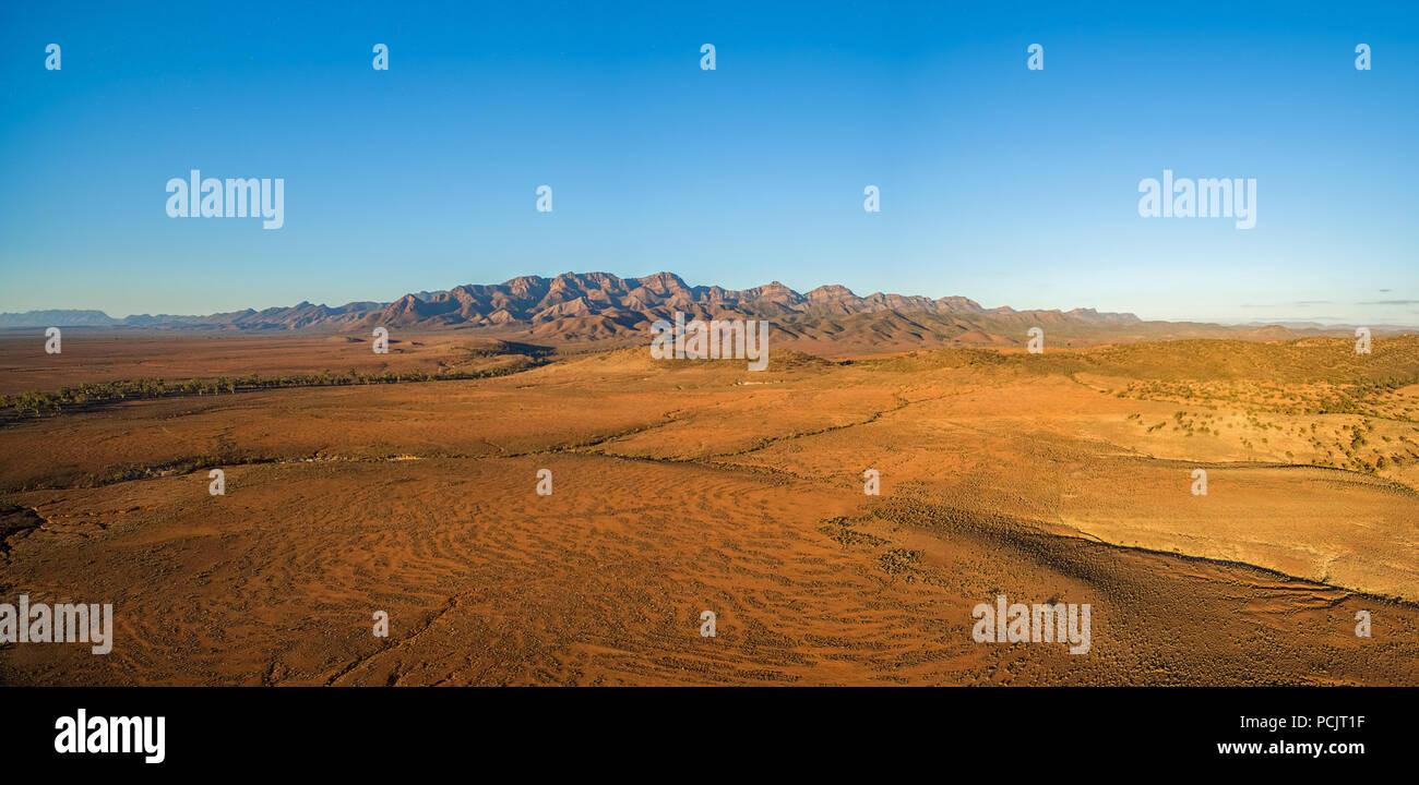 Aerial panorama of Flinders Ranges at orange sunset in South Australia - Stock Image
