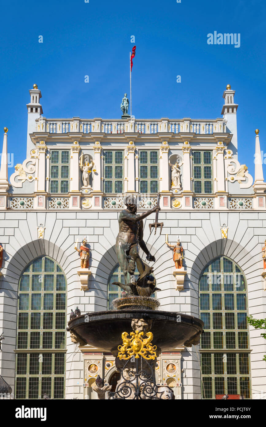 View of Baroque figures sited on the Neptune Fountain and Artus Court Museum in the historical Royal Way thoroughfare of Gdansk Old Town, Poland. Stock Photo