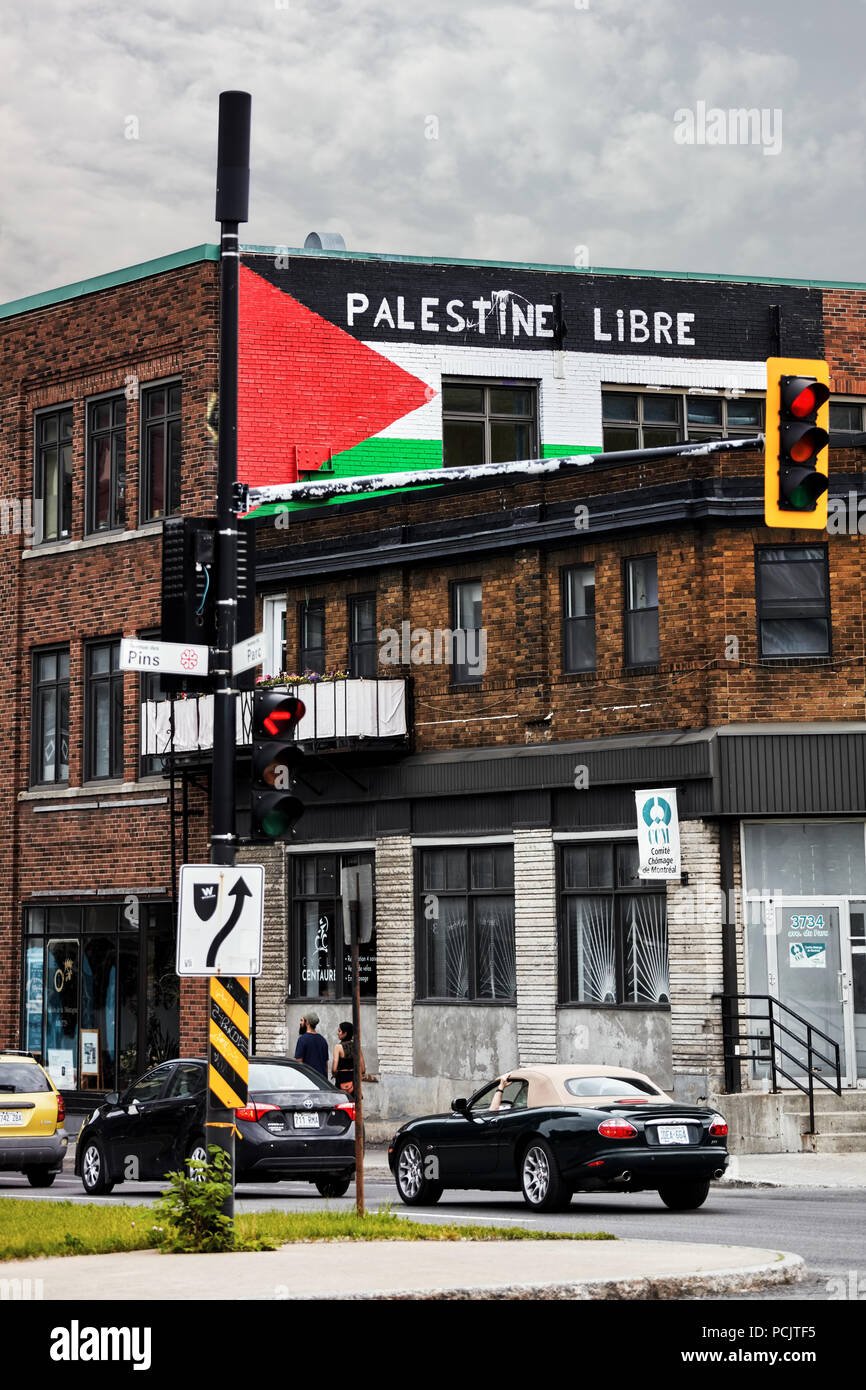 Palestine flag and free Palestine (palestine libre) slogan in French painted on the brick walls of a building in Montreal, Quebec, Canada. - Stock Image