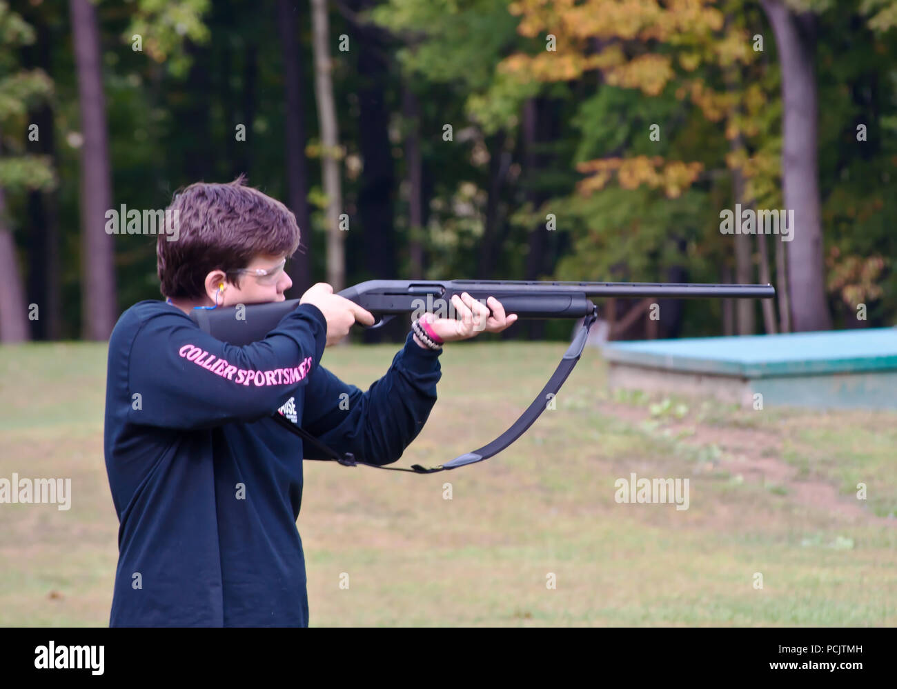 A young man taking aim on the line trap shooting at the Collier's Sportsman club in Collier, PA, USA Stock Photo