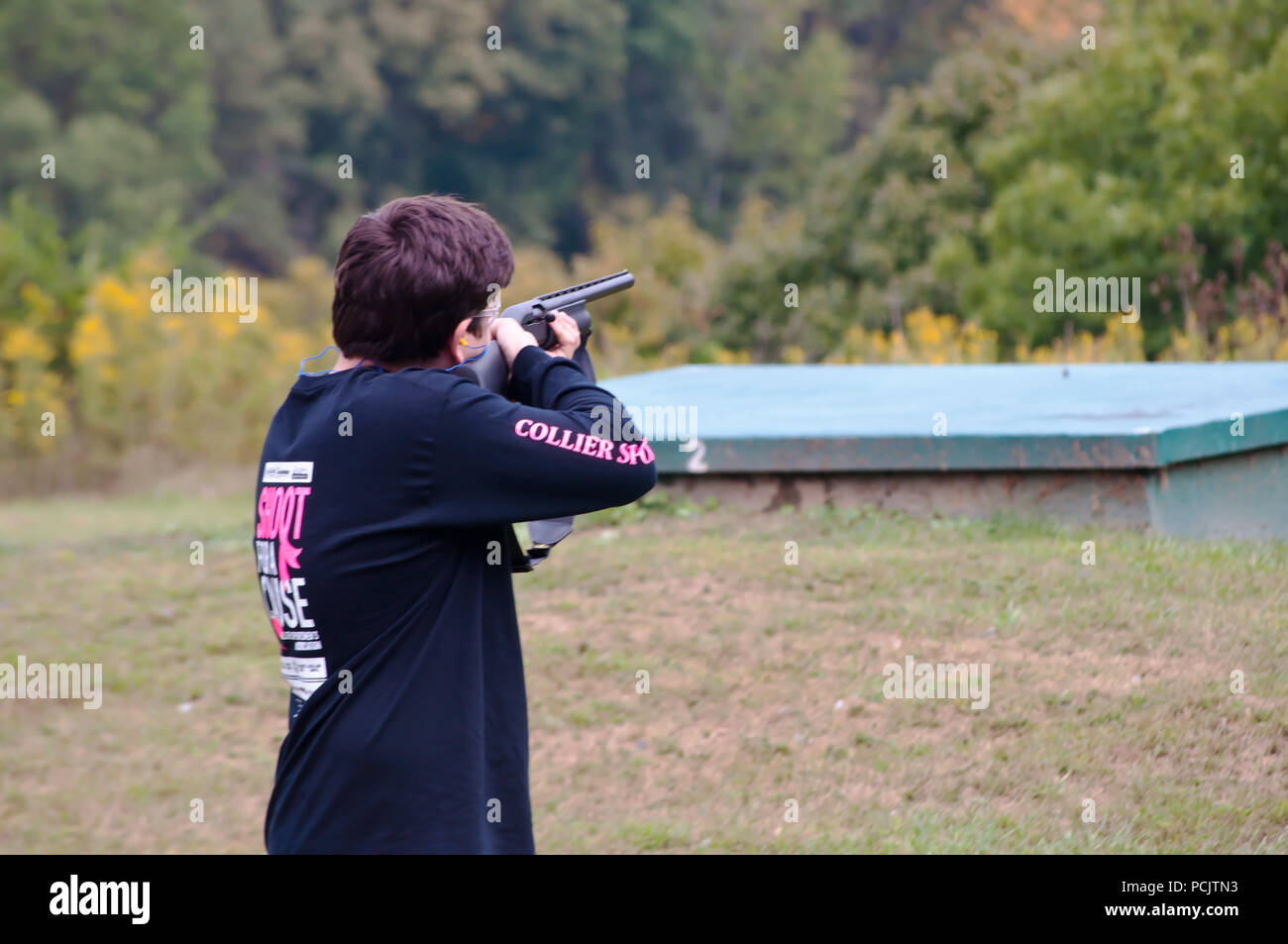 A young man taking aim on the line trap shooting at the Collier's Sportsman club in Collier, PA, USA - Stock Image