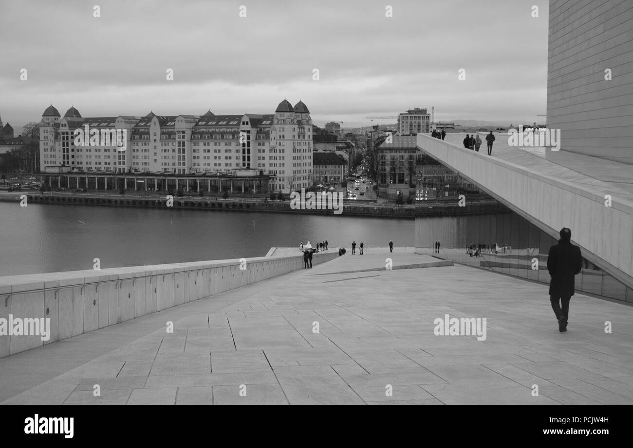 A man walking on the roof top of Oslo Opera House Stock Photo