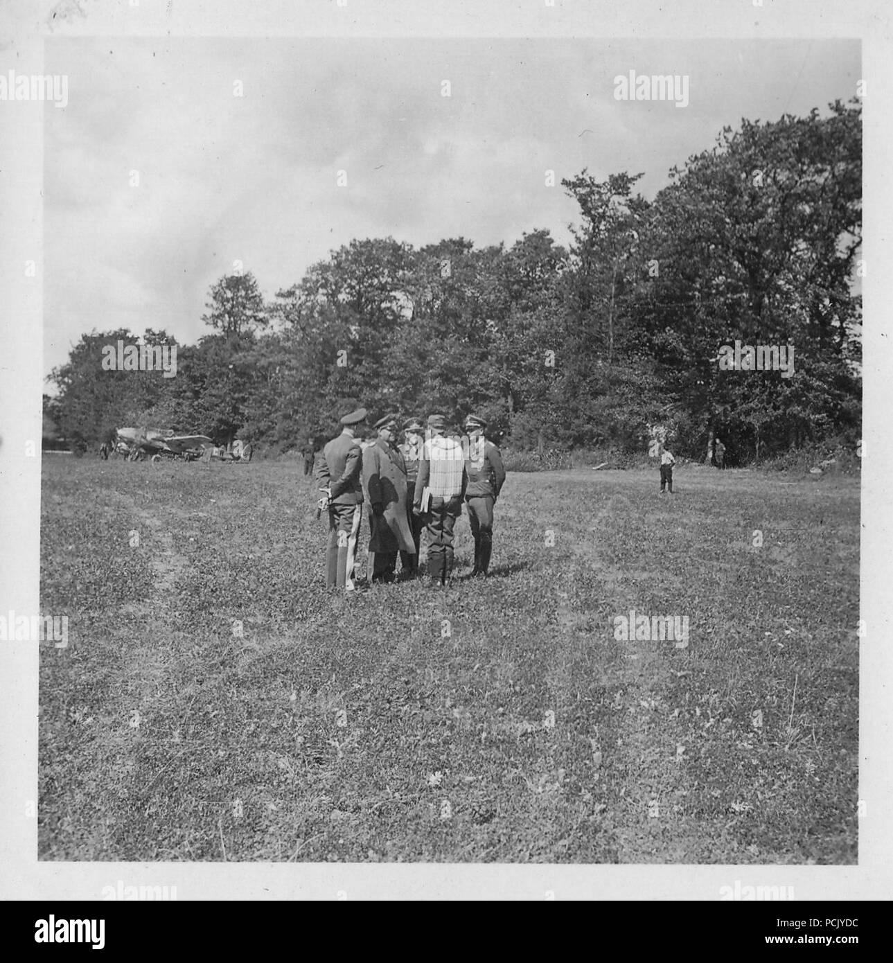 Image from a photo album relating to II. Gruppe, Jagdgeschwader 3: Feldmarschall Albert Kesselring in discussion with Hauptmann Erich von Selle and other officers of II./JG3 at Wierre-au-Bois airfield in France, summer 1940. In the background is one of the units Messerschmitt Bf 110 heavy fighters. - Stock Image