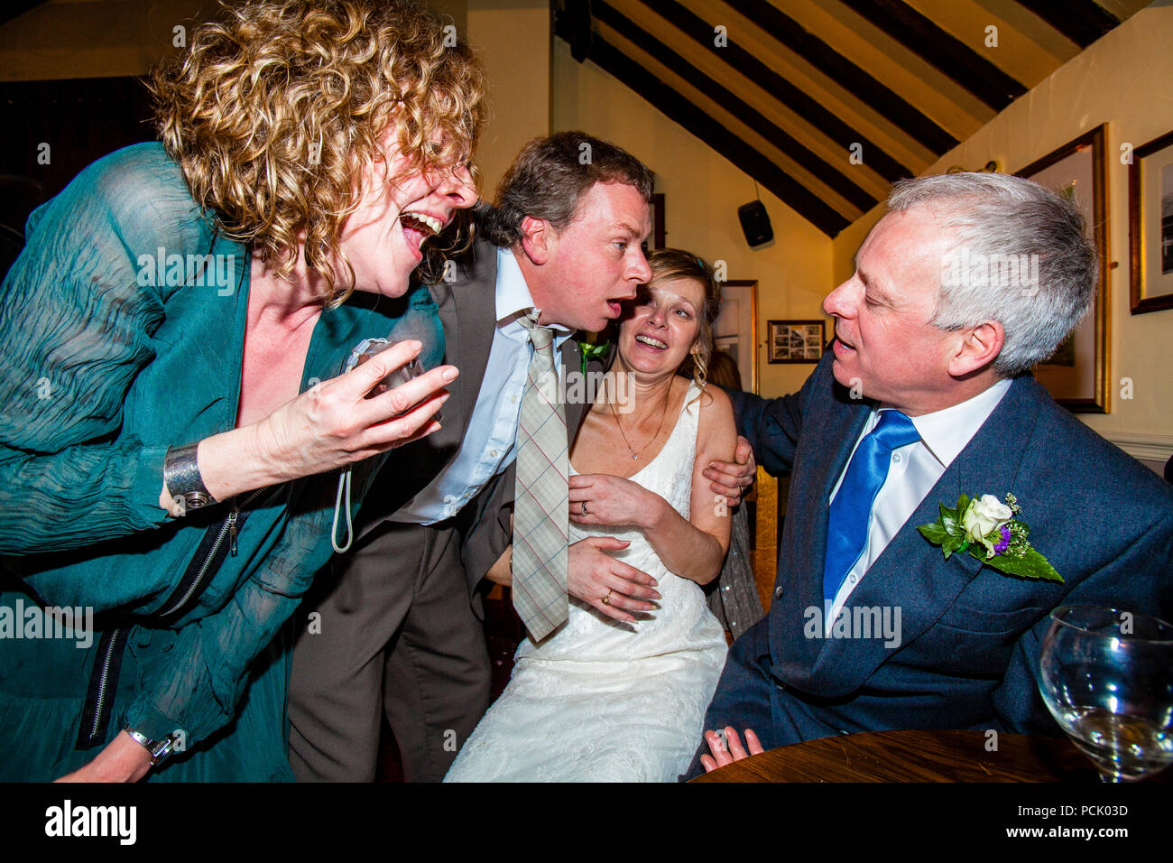 A Bride and Wedding Guests, Sussex, UK - Stock Image