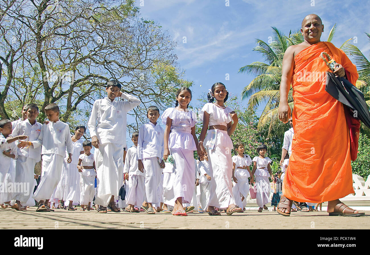 Monk and students (Novices), Temple of the Tooth, Kandy Sri Lanka - Stock Image