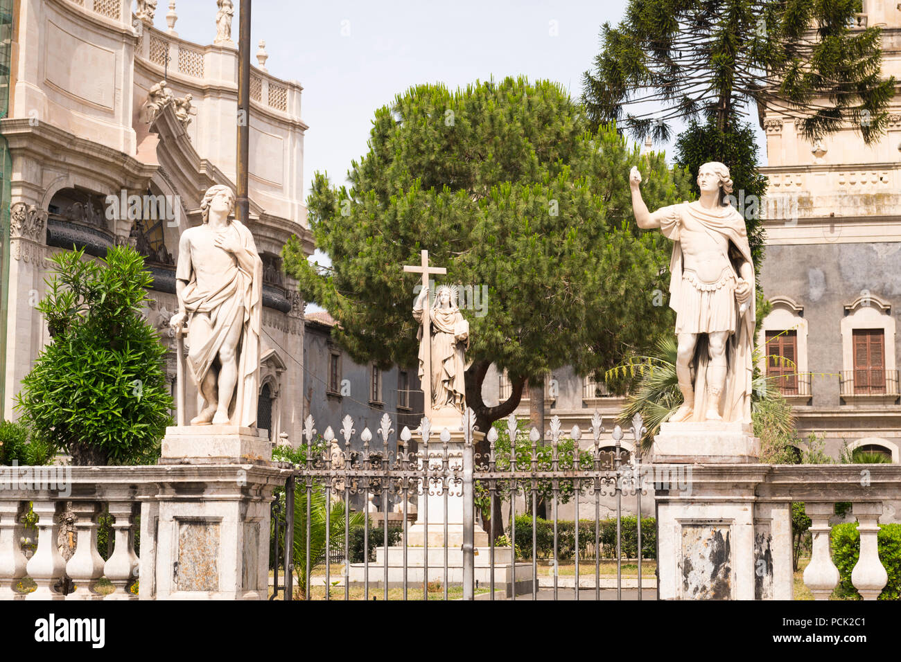 Italy Sicily Catania Piazzo Duomo Baroque Cathedral patron saint Sant Agata G B Vaccarini stone statues sculptures garden park grounds metal railings - Stock Image