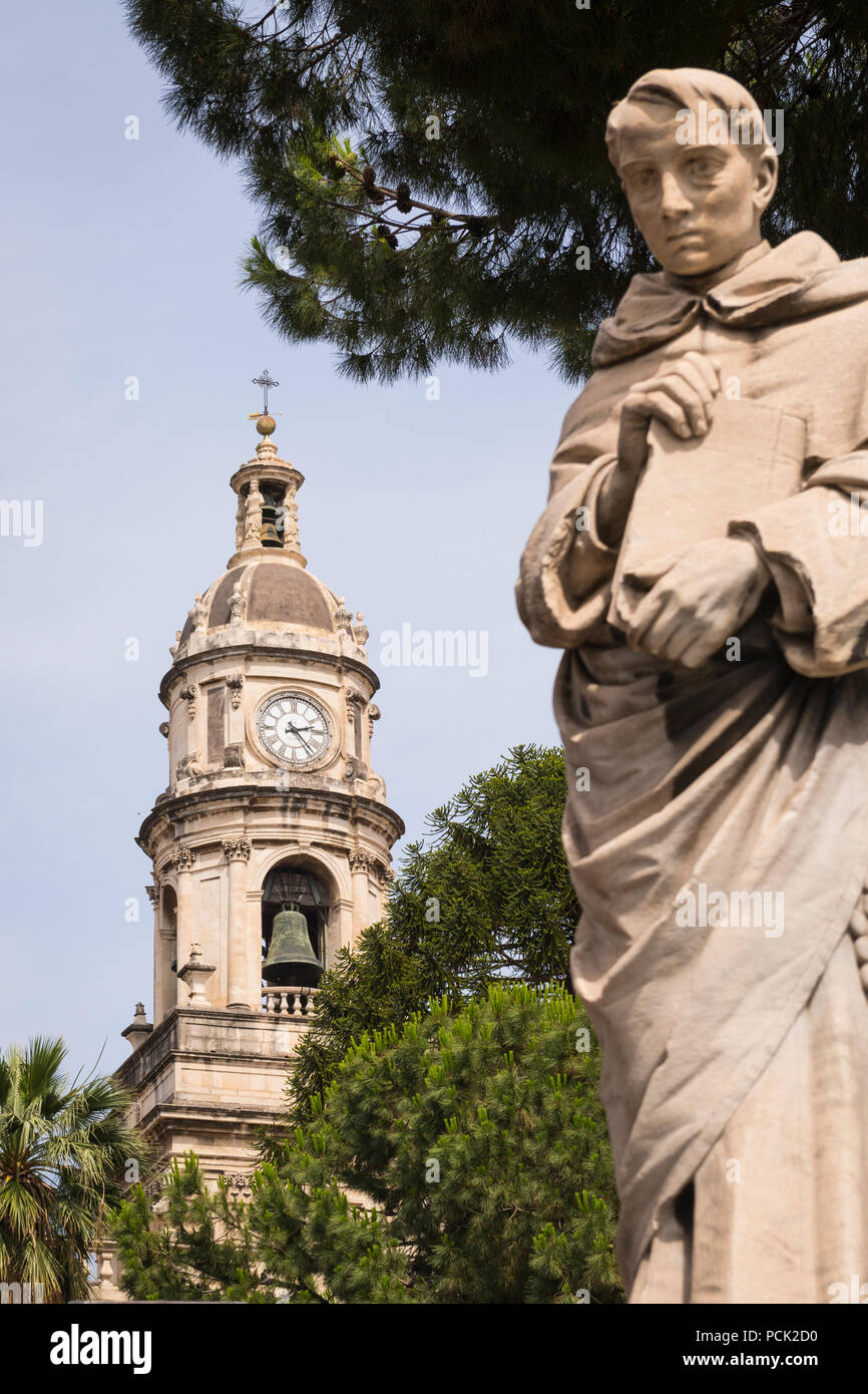 Italy Sicily Catania Piazzo Duomo Baroque Cathedral patron saint Sant Agata G B Vaccarini stone statues sculptures blue sky clock bell tower - Stock Image