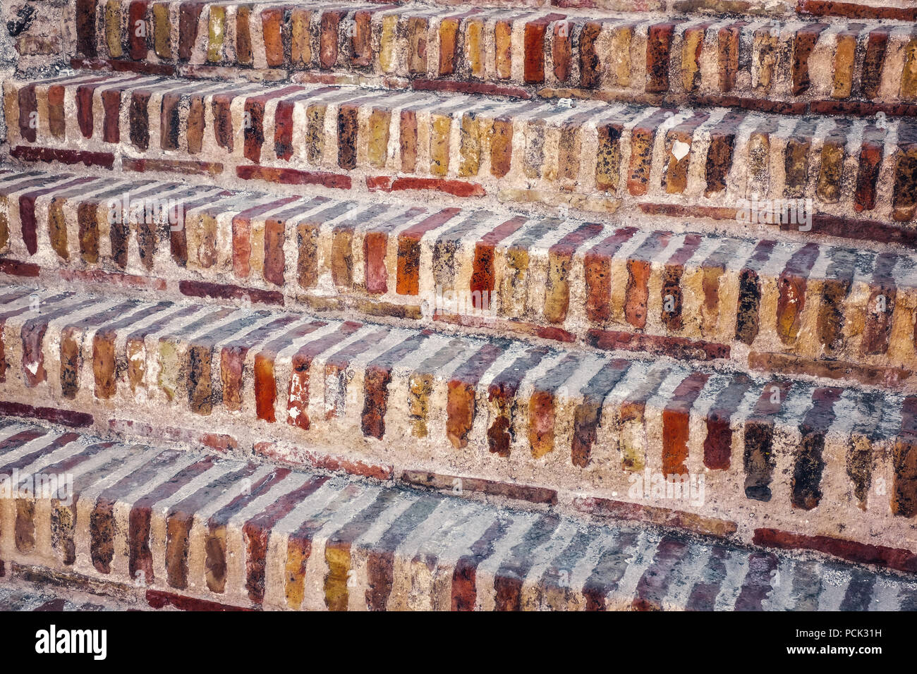 Steps of red old bricks - Stock Image