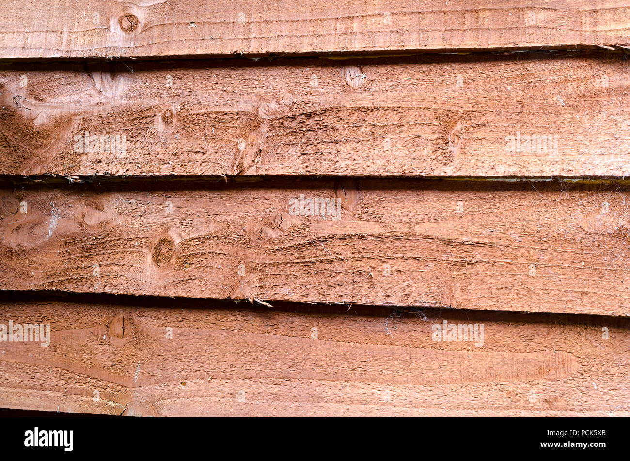 A Background of Brown Overlap Timber - Stock Image