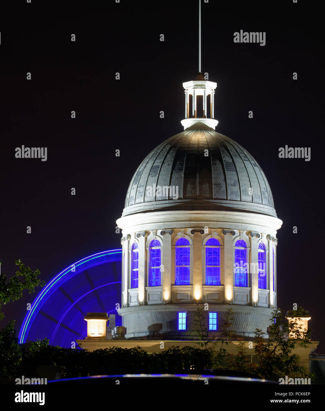 The Dome of the Marché Bonsecours in Montreal Old Port with the big wheel La Grande Roue turning behind - Stock Image