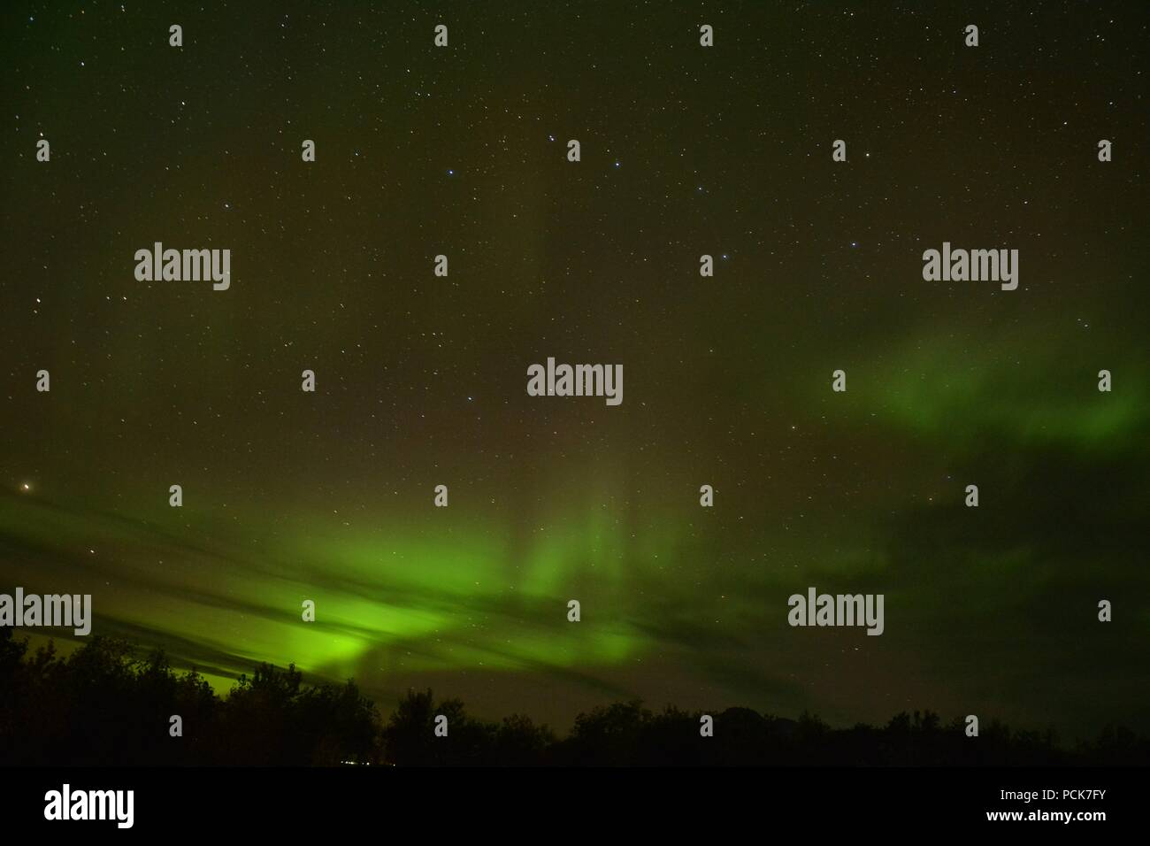 The Northern Lights in Akureyri, Iceland at night - Stock Image