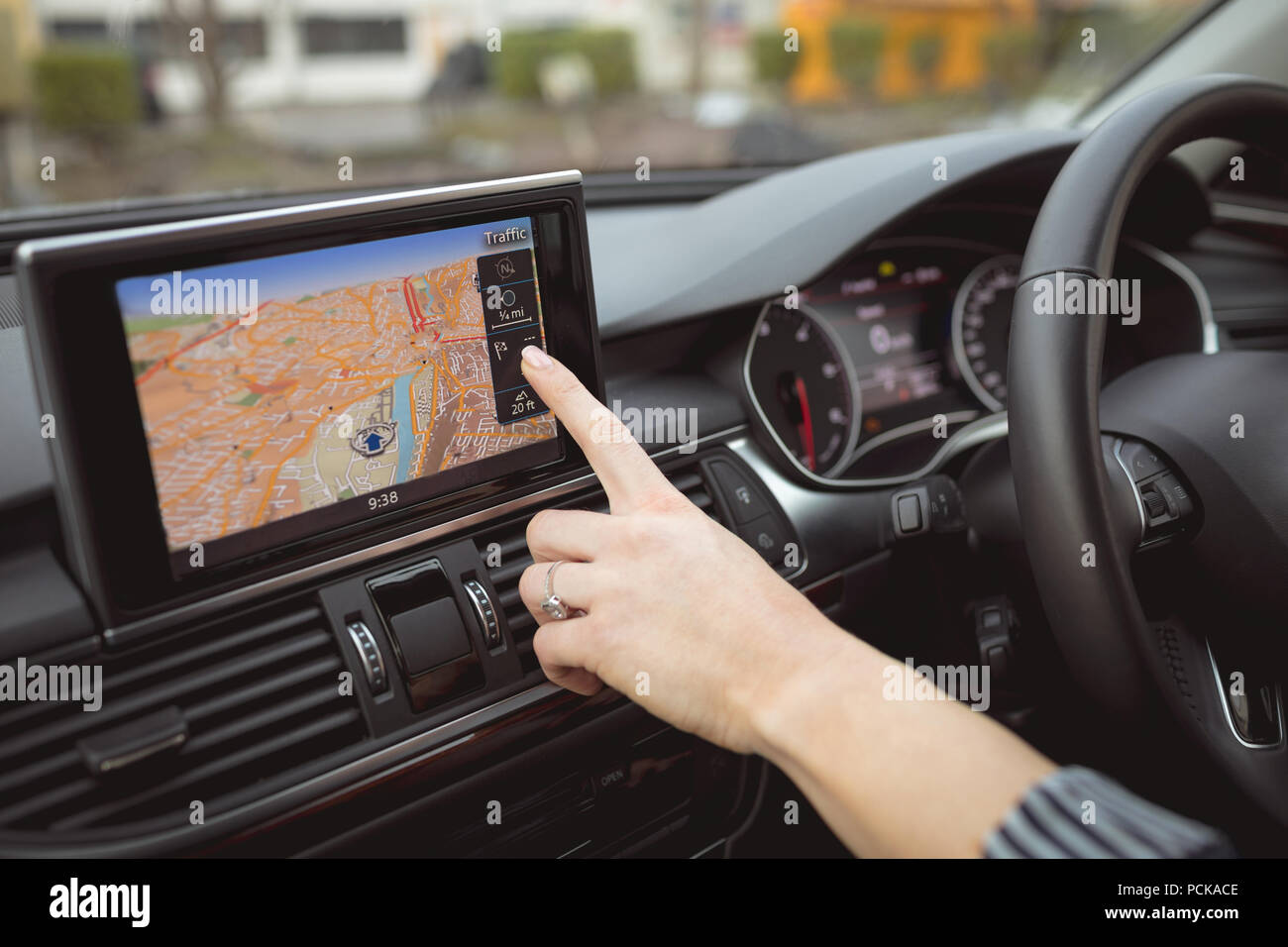 Female executive using navigation in a car - Stock Image