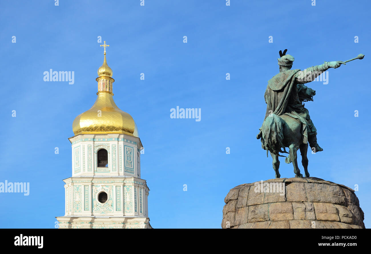 Bell tower and sculpture of the man on a horse are in the sky. Saint Sophia Cathedral and the Bohdan Khmelnytskyi monument are religious and historica - Stock Image