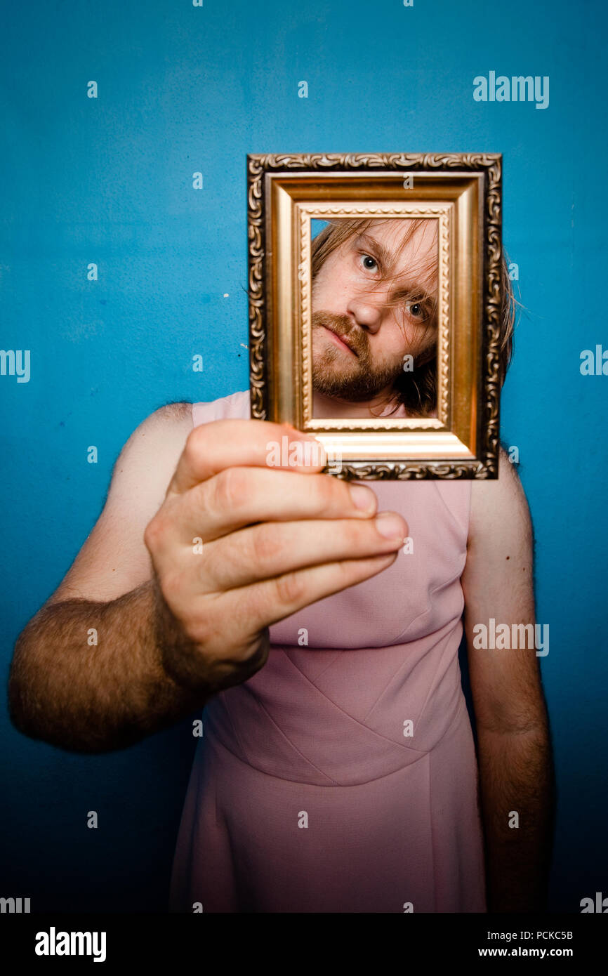 perspective,picture frame,humor,bizarre - Stock Image