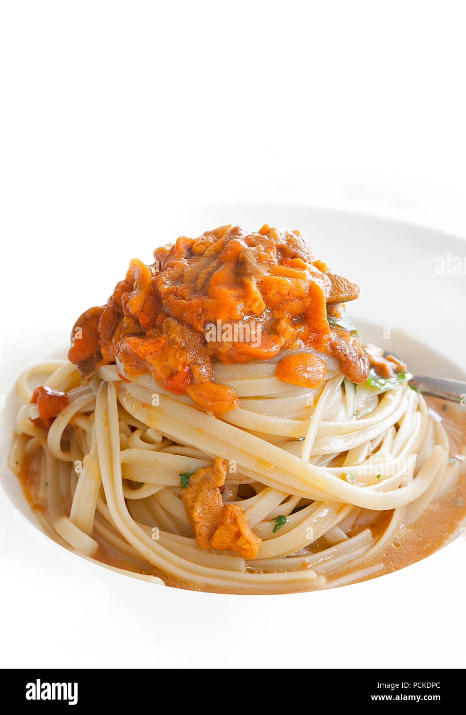 Sea Urchin Linguine. Mediterranean Food Delicacy. Close-up with a white background. Stock Image. - Stock Image