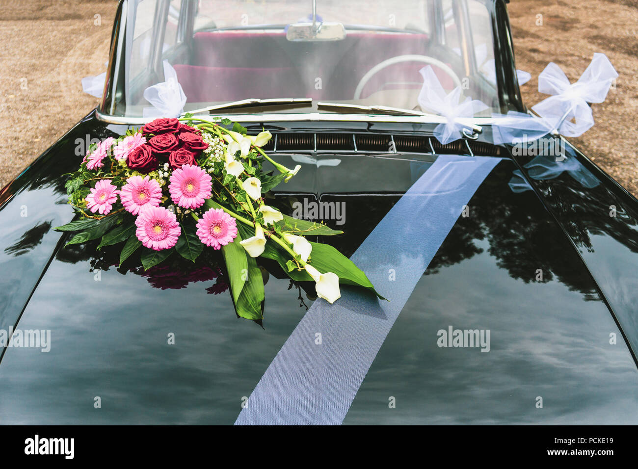 Vintage Black Car Decorated With Bouqet Bunch Of Flowers And White